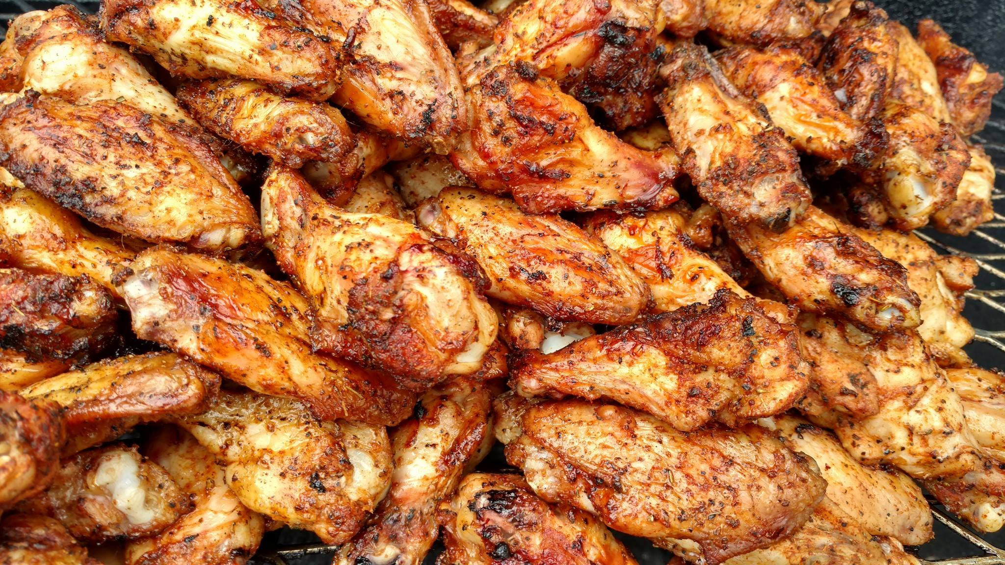 Our wings are cooked over charcoal. Never fried.
